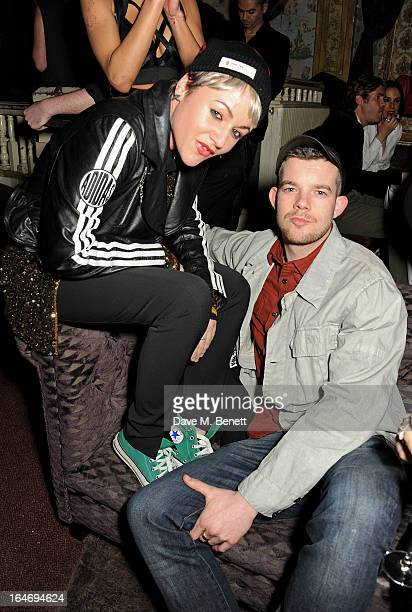 Jaime Winstone and Russell Tovey attend the ABSOLUT Elyx launch party at The Box Soho on March 26 2013 in London England
