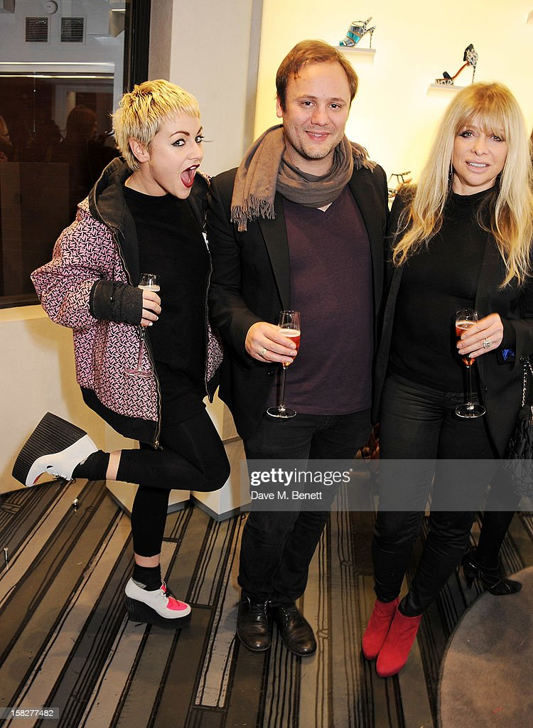Jaime Winstone, Nicholas Kirkwood and Jo Wood attend a Christmas drinks hosted by designer Nicholas Kirkwood to celebrate his partnership with Chambord black raspberry liquer, and launch the limited edition shoe 'The Chambord' at the Nicholas Kirkwood Mount Street store on December 12, 2012 in London, England.