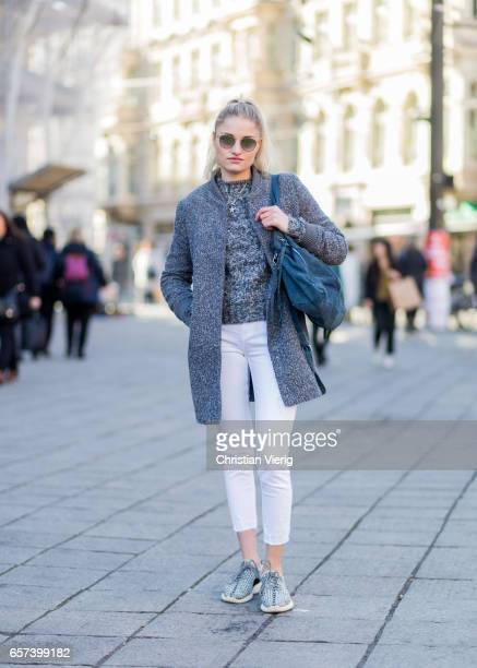 Jaimee Lau wearing a grey sweater white cropped jeans grey coat sunglasses Yeezy sneaker on March 24 2017 in Berlin Germany