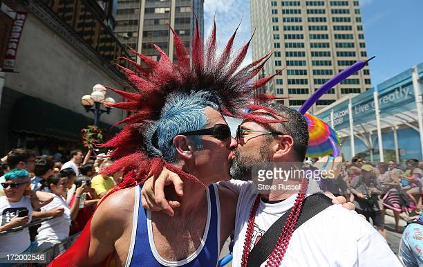 TORONTO ON JUNE 30 Jaimie Godin and Christopher kiss as they march in the Toronto Gay Pride Parade which attracts a million people who line the route...