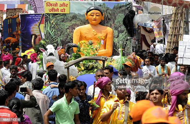 Jain community members taking part in a religious procession taken out to mark the Mahavir Jayanti at Sadar Bazar on April 2 2015 in New Delhi India...