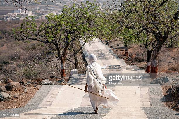Jain nun walking down the path from Palitana temples on Shatrunjaya hill Gujarat India Palitana is the worlds only mountain that has more than 900...