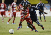 Jair Benitez of FC Dallas races for control of the ball with Marvin Chavez of the San Jose Earthquakes during the first half of an MLS Soccer game at...