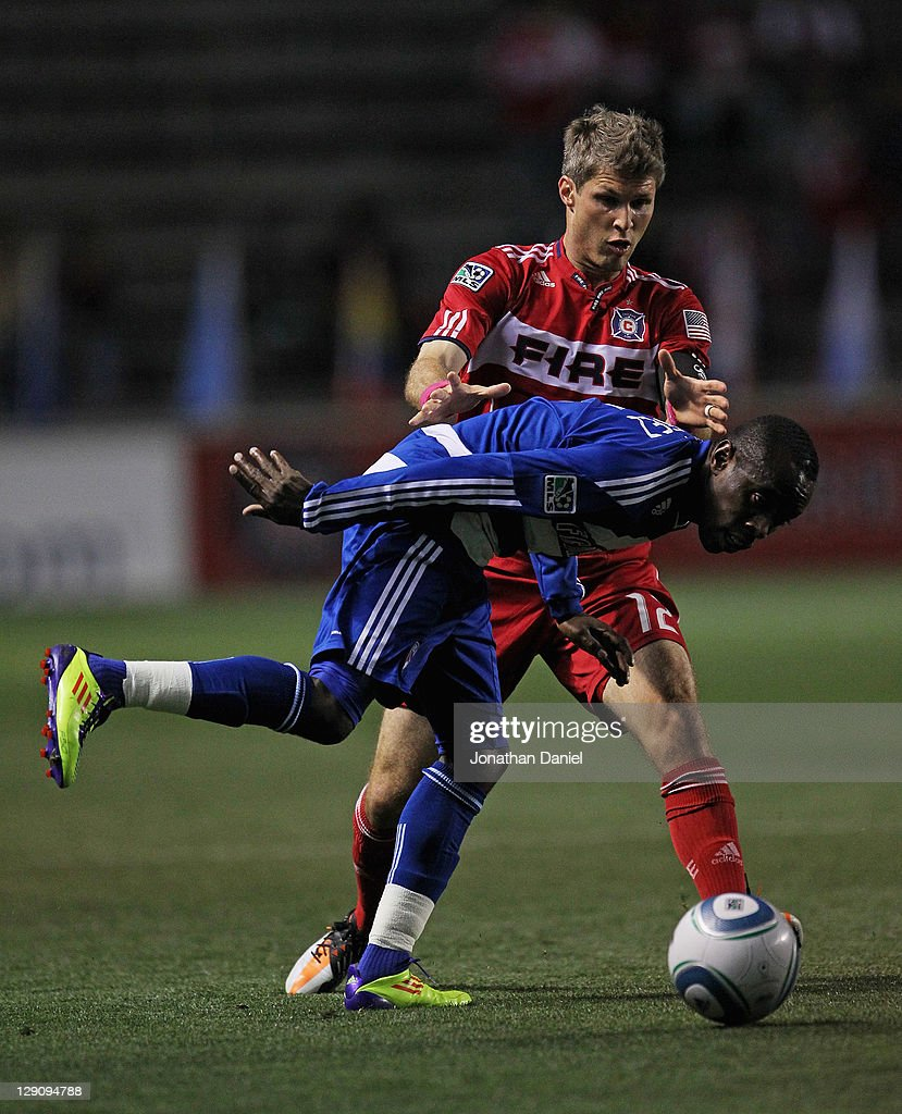 Jair Benitez #5 of FC Dallas tires to control the ball under pressure from Logan Pause #12 of the Chicago Fire during an MLS match at Toyota Park on October 12, 2011 in Bridgeview, Illinois.