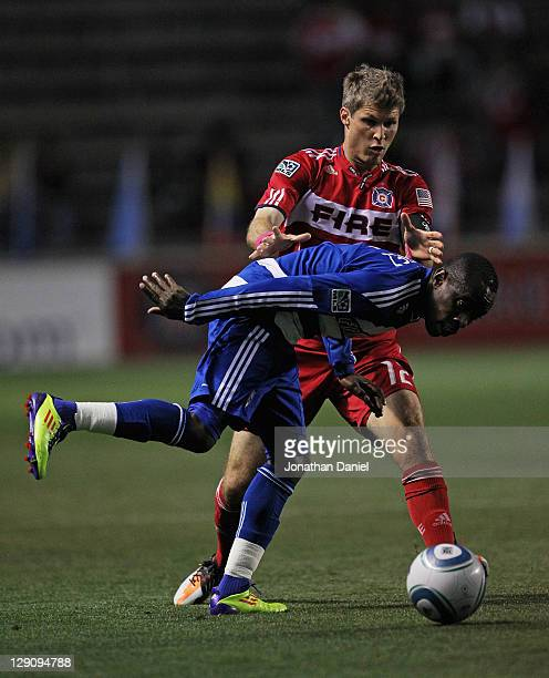 Jair Benitez of FC Dallas tires to control the ball under pressure from Logan Pause of the Chicago Fire during an MLS match at Toyota Park on October...