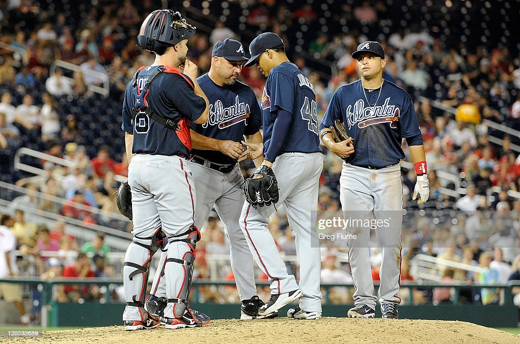 <a gi-track='captionPersonalityLinkClicked' href=/galleries/search?phrase=Jair+Jurrjens&family=editorial&specificpeople=844086 ng-click='$event.stopPropagation()'>Jair Jurrjens</a> #49 of the Atlanta Braves is removed from the game by manager <a gi-track='captionPersonalityLinkClicked' href=/galleries/search?phrase=Fredi+Gonzalez&family=editorial&specificpeople=686896 ng-click='$event.stopPropagation()'>Fredi Gonzalez</a> #33 in the sixth inning against the Washington Nationals at Nationals Park on August 1, 2011 in Washington, DC.