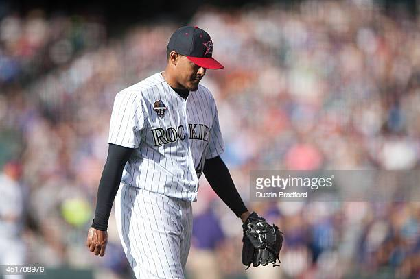 Jair Jurrjens of the Colorado Rockies reacts after giving up three runs in the first inning of a game against the Los Angeles Dodgers at Coors Field...