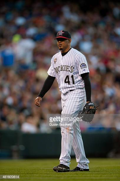 Jair Jurrjens of the Colorado Rockies walks off the field after being pulled for a relief pitcher in the fifth inning of a game against the Los...