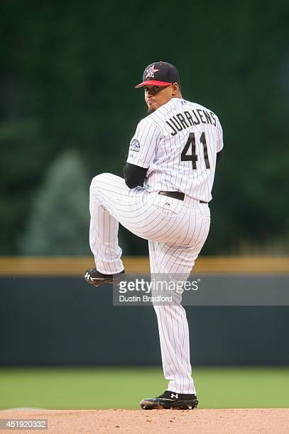 Jair Jurrjens of the Colorado Rockies winds up to deliver a pitch in the first inning of a game against the Los Angeles Dodgers at Coors Field on...