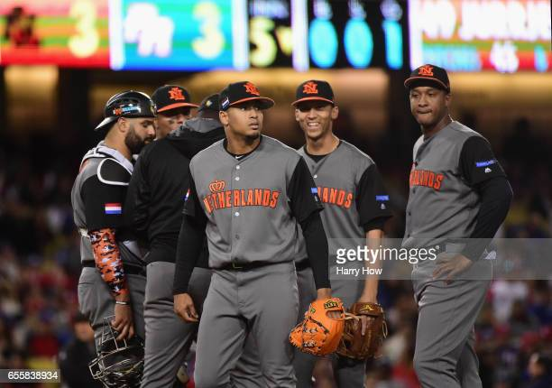 Jair Jurrjens of the Netherlands leaves the game with a tied score 33 in the fifth inning against team Puerto Rico during Game 1 of the Championship...