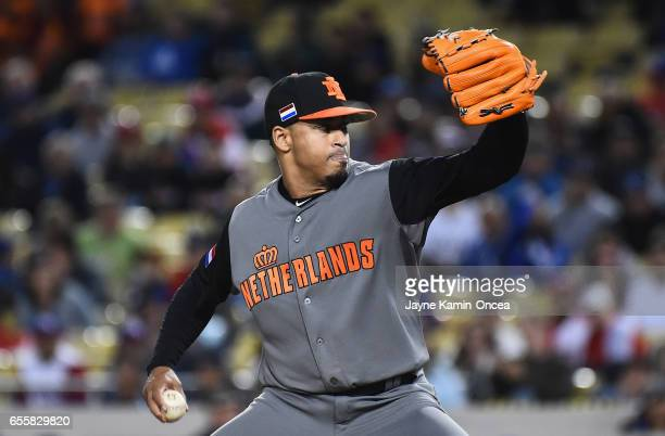Jair Jurrjens of the Netherlands relief pitcher pitches against team Netherlands in the third inning during Game 1 of the Championship Round of the...