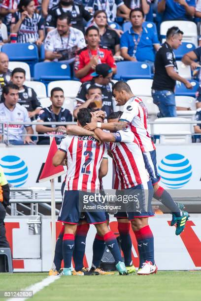 Jair Pereira of Chivas celebrates with teammates after scoring his team's first goal during the 4th round match between Monterrey and Chivas as part...
