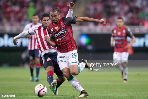 Jair Pereira of Chivas fights for the ball with Carlos Gonzalez of Necaxa during the third round match between Chivas and Necaxa as part of the...