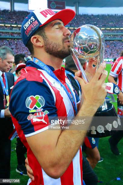Jair Pereira of Chivas kisses the champions trophy after the Final second leg match between Chivas and Tigres UANL as part of the Torneo Clausura...