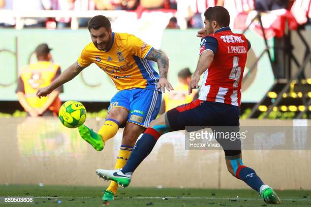 Jair Pereira of Chivas struggles for the ball with Andre Pierre Gignac of Tigres during the Final second leg match between Chivas and Tigres UANL as...