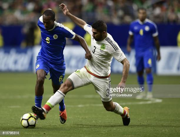 Jair Pereira of Mexico works the ball against Quenten Martinus of Curacao during their CONCACAF Gold Cup soccer match on July 16 2017 at the...
