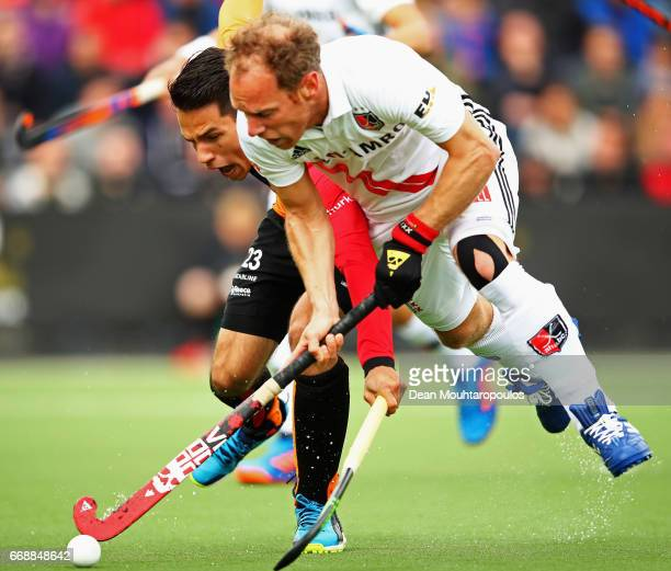 Jair Van Der Horst of HC OranjeRood battles for the ball with Teun Rohof of AH BC Amsterdam during the Euro Hockey League KO16 match between HC...