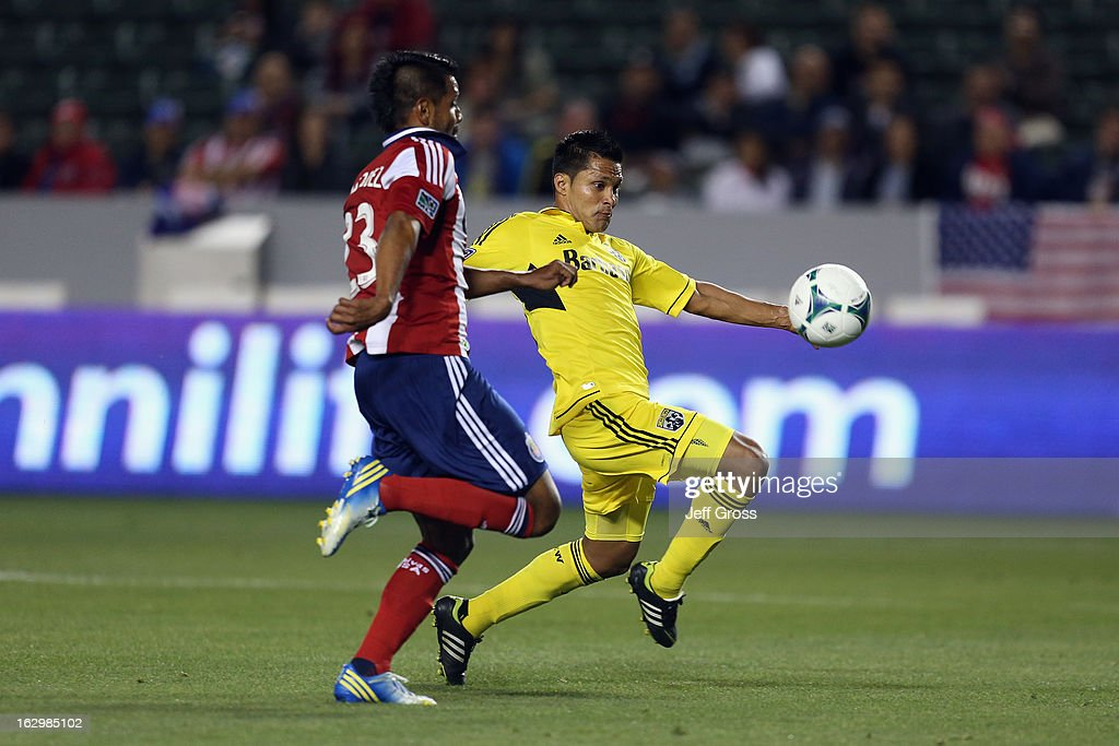 Jairo Arrieta #25 of Columbus Crew is pursued by Joaquin Velasquez #23 of Chivas USA for the ball in the first half at The Home Depot Center on March 2, 2013 in Carson, California.