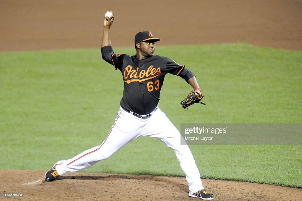 Jairo Asencio #63 pitches during a baseball game against the Toronto Blue Jays on July 12, 2013 at Oriole Park at Camden Yards in Baltimore, Maryland.