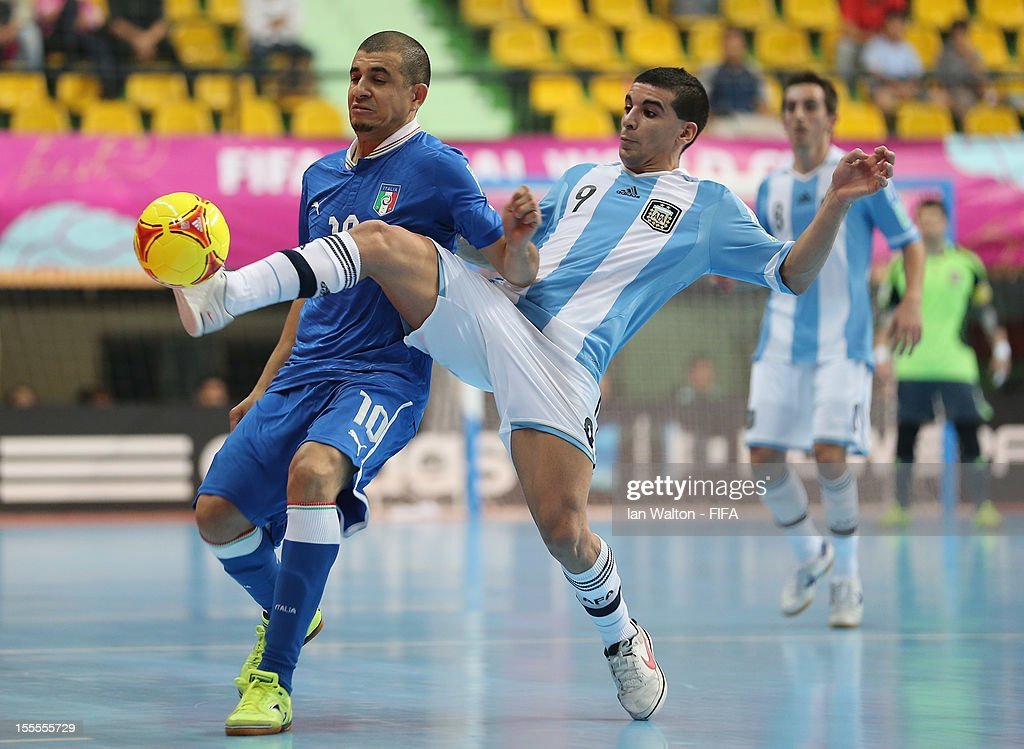 Jairo Dos Santos of Italy is tackled by Cristian Borruto of Argentina during the FIFA Futsal World Cup Thailand 2012, Group D match between Argentina and Italy at Nimibutr Stadium on November 5, 2012 in Bangkok, Thailand.