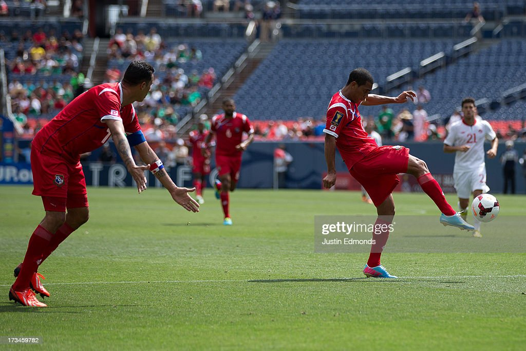 Jairo Jimenez #18 of Panama shoots the ball as teammate Blas Perez #7 looks for a pass during the second half of a CONCACAF Gold Cup match against Canada at Sports Authority Field at Mile High on July 14, 2013 in Denver, Colorado. Canada and Panama played to a 0-0 draw.