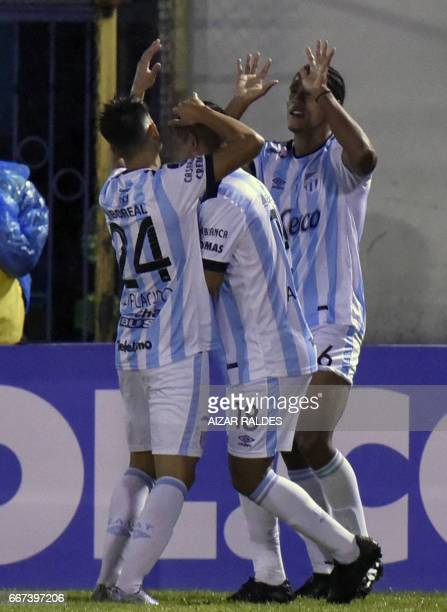 Jairo Palomino of Atletico Tucuman of Argentina celebrates with teammates after scoring against Wilstermann of Bolivia during their Copa Libertadores...