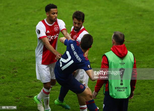 Jairo Riedewald of Ajax and Amin Younes of Ajax confront Ander Herrera of Manchester United during the UEFA Europa League Final between Ajax and...