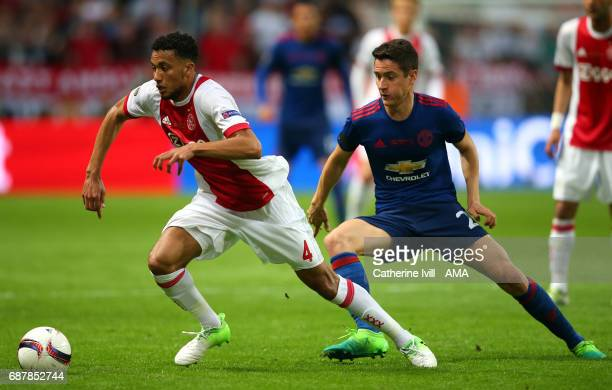 Jairo Riedewald of Ajax and Ander Herrera of Manchester United compete during the UEFA Europa League Final between Ajax and Manchester United at...