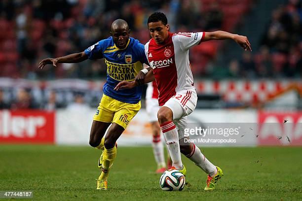 Jairo Riedewald of Ajax and Jody Lukoki of Cambuur battle for the ball during the Eredivisie match between Ajax Amsterdam and SC Cambuur Leeuwarden...