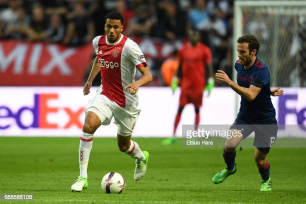 Jairo Riedewald of Ajax and Juan Mata of Manchester United compete for the ball during the UEFA Europa League final match between Ajax and Manchester...