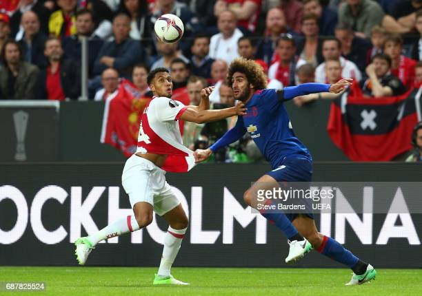 Jairo Riedewald of Ajax and Marouane Fellaini of Manchester United battle for possession during the UEFA Europa League Final between Ajax and...