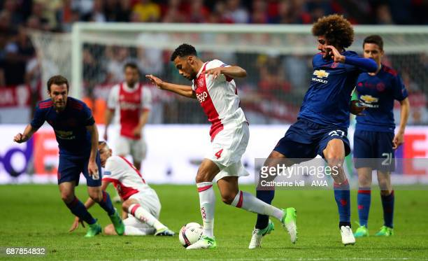 Jairo Riedewald of Ajax and Marouane Fellaini of Manchester United compete during the UEFA Europa League Final between Ajax and Manchester United at...