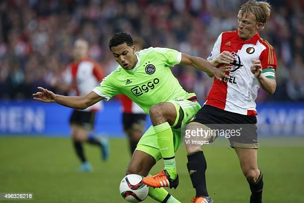 Jairo Riedewald of Ajax Dirk Kuyt of Feyenoord during the Dutch Eredivisie match between Feyenoord Rotterdam and Ajax Amsterdam at the Kuip on...