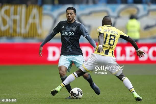Jairo Riedewald of Ajax Marvelous Nakamba of Vitesseduring the Dutch Eredivisie match between Vitesse Arnhem and Ajax Amsterdam at Gelredome on...