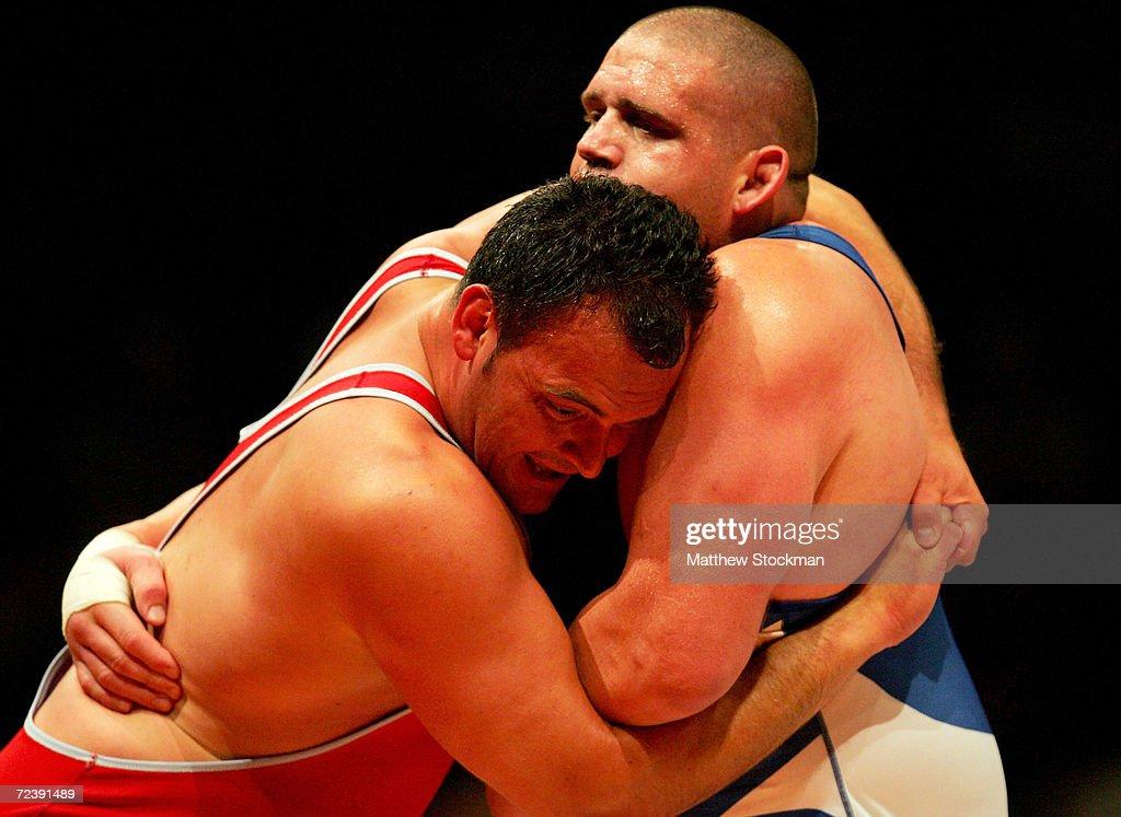 Jairo Rodriques of Spain wrestles Rulon Gardner in the 120 kg division during the Titan Games June 20 2004 at Phillips Arena in Atlanta Georgia