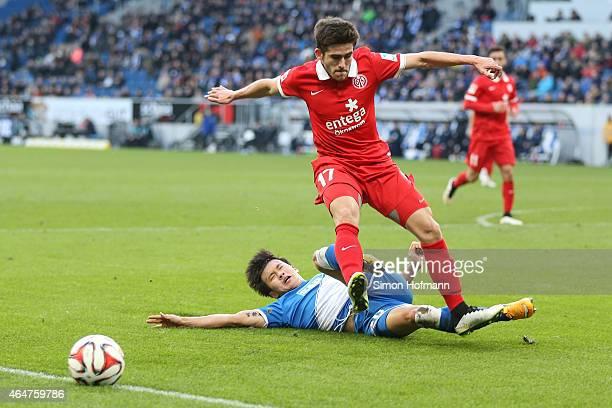 Jairo Samperio of Mainz is challenged by JinSu Kim of Hoffenheim during the Bundesliga match between 1899 Hoffenheim and 1 FSV Mainz 05 at Wirsol...