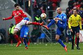 Jairo Samperio of Mainz is challenged by Konstantin Rausch of Darmstadt during the Bundesliga match between 1 FSV Mainz 05 and SV Darmstadt 98 at...