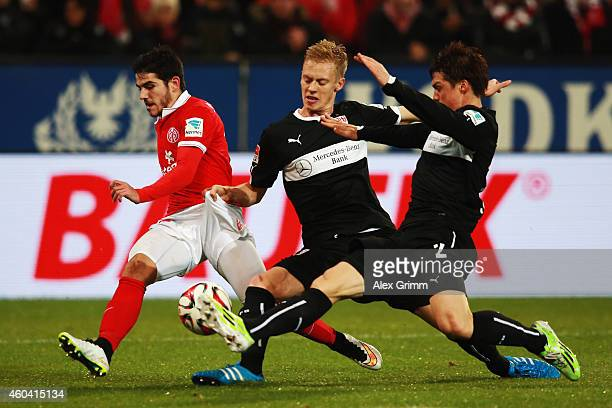 Jairo Samperio of Mainz is challenged by Timo Baumgartl and Gotoku Sakai of Stuttgart during the Bundesliga match between 1 FSV Mainz 05 and VfB...