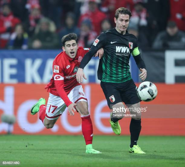 Jairo Semperio of Mainz is challenged by Paul Verhaegh of Augsburg during the Bundesliga match between 1 FSV Mainz 05 and FC Augsburg at Opel Arena...