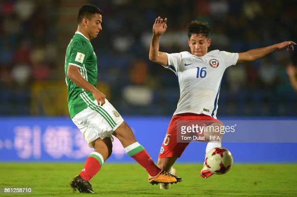 Jairo Torres of Mexico and Oliver Rojas of Chile in action during the FIFA U17 World Cup India 2017 group E match between Mexico and Chile at Indira...