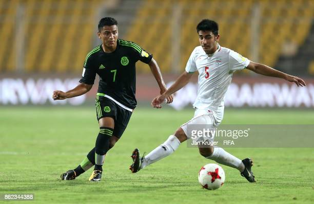 Jairo Torres of Mexico battles with Majid Nasiri of Iran during the FIFA U17 World Cup India 2017 Round of 16 match between Iran and Mexico at Pandit...