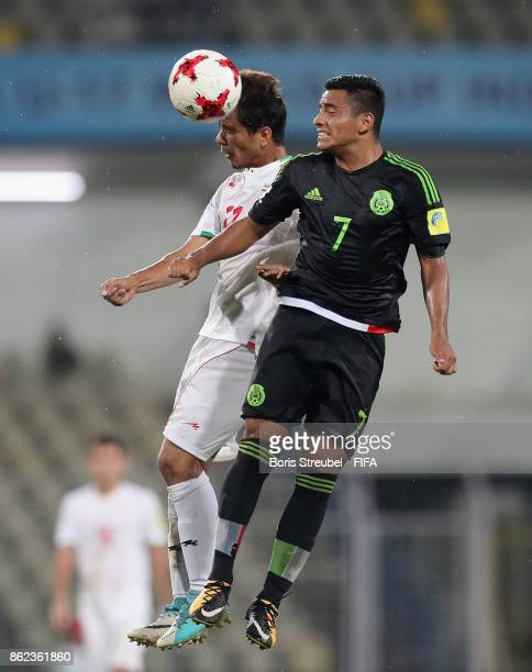 Jairo Torres of Mexico jumps for a header with Amir Khoda Moradi of Iran during the FIFA U17 World Cup India 2017 Round of 16 match between Iran and...