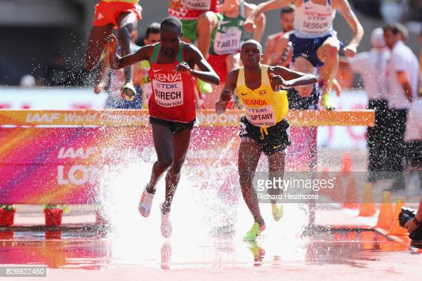 Jairus Kipchoge Birech of Kenya and Jacob Araptany of Uganda competes in the Men's 3000 metres Steeplechase during day three of the 16th IAAF World...