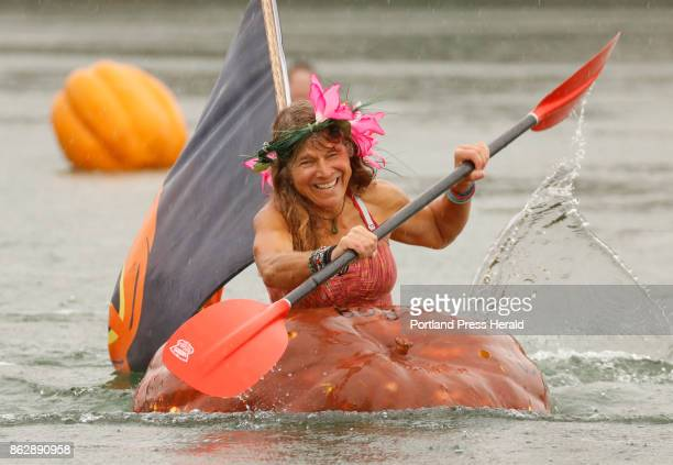 Jaja Martin of Bremen joyfully paddles during the Pumpkin Regatta part of the Pumpkinfest in Damariscotta on Monday October 9 2017 In addition to the...