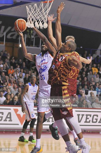 JaJuan Johnson of Acqua Vitasnella competes with Josh Owens of Umana during the LegaBasket match between Reyer Umana Venezia and Acqua Vitasnella...