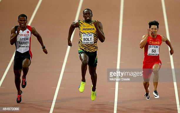 Jak Ali Harvey of Turkey Usain Bolt of Jamaica and Bingtian Su of China cross the finish line in the Men's 100 metres semifinal during day two of the...