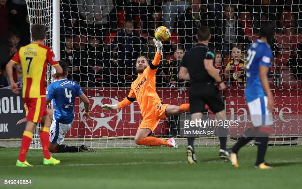 Jak Alnwick of Rangers saves from Conor Sammon of Partick Thistle during the Betfred League Cup Quarter Final at Firhill Stadium on September 19 2017...