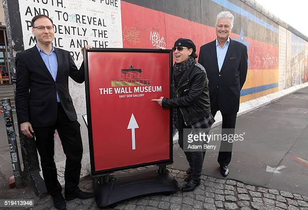 Jaka Bizilj film producer Klaus Meine singer of the band Scorpions and Guido Knopp journalist pose during the opening of 'The Wall Museum East Side...