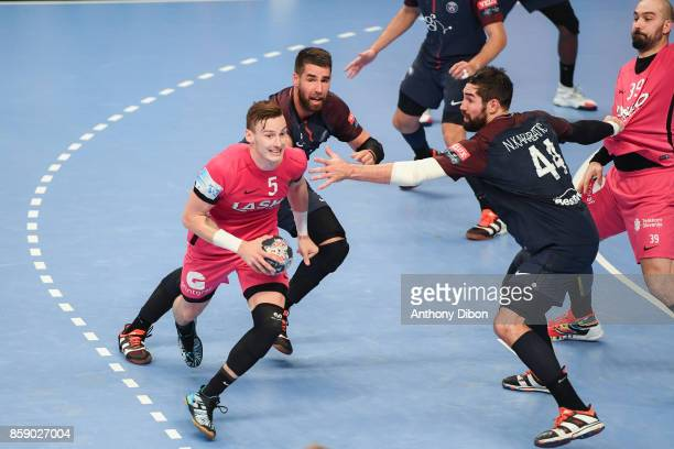 Jaka Malus of Celje Luka karabatic and Nikola Karabatic of PSG fights for the ball during the EHB Champions League match between Paris Saint Germain...