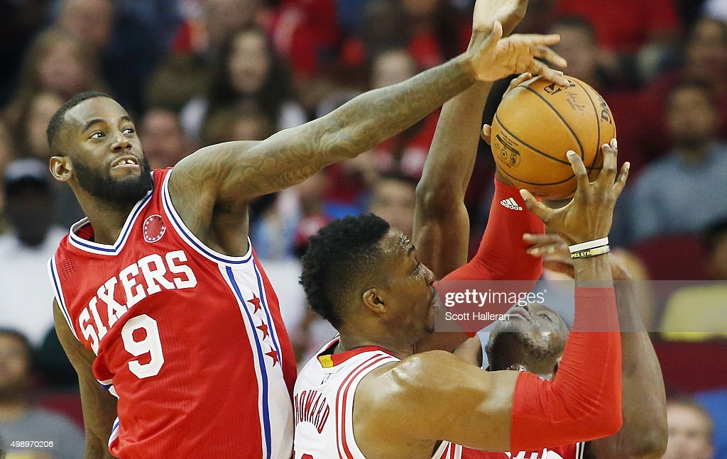 JaKarr Sampson of the Philadelphia 76ers blocks a shot by Dwight Howard of the Houston Rockets during their game at the Toyota Center on November 27...